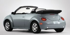The base-model 2003 Volkswagen New Beetle convertible had a manual folding top. All other versions had power operation for the tight-sealing soft top.