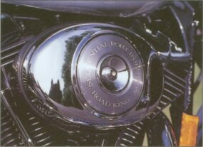 "The 1999 Harley-Davidson Road King featured several ""Classic"" features, including distinct tank badges."