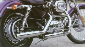 A cast 16-inch rear wheel and spoke 21-inch front wheel are featured on the 2002 Harley-Davidson XL-1200C Sportster.