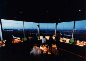 Air traffic controllers in the tower monitor takeoffs, landings and ground traffic with visual and radar tools.