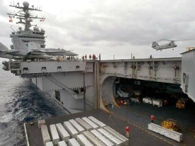 One of the hydraulic elevators on the USS George Washington, lowered to the hangar deck