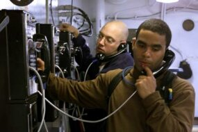 Sailors phoning home onboard the USS Harry S. Truman