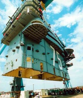Lowering superlifts into position on the USS Harry S. Truman