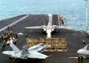An F-14 Tomcat, positioned in front of the jet blast deflector on USS Nimitz's catapult number 1
