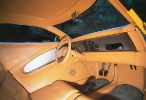 The Aluma Coupe's interior has custom-made Connolly seats and a Boyd steering wheel.