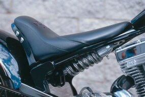 The under-seat spring/shock for the rear suspension is fully adjustable for comfort and chrome-plated for pizzazz.
