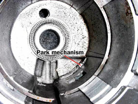 Figure 2. The empty housing of the transmission with the parking brake mechanism poking through, as it does when the car is in park.