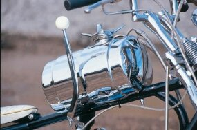 The tall Hurst shift lever beside the Bad Moon's fuel tank is another automotive icon of the 1960s.