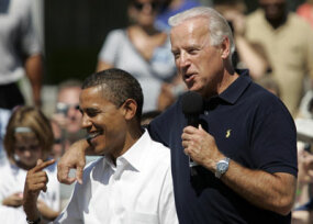 Joe Biden and Barack Obama share a laugh on the campaign trail in Toledo, Ohio.