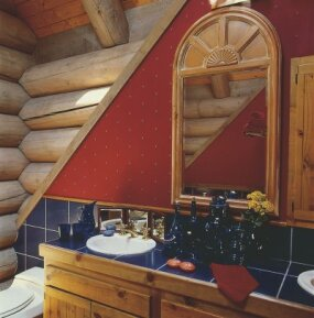 Bold colors highlight the intriguing shapes in this lodge-style bathroom.