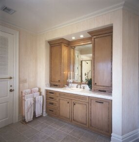 Custom-made bathroom cabinets are trimmed in bamboo for a subtly exotic touch.
