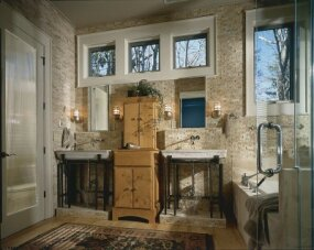 Marble vanities add a sense of ancient elegance to this bath.