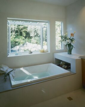 The sun-bathed tub offers personal luxury.