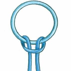 Start your kite beaded key chain by looping lanyard around the ring.