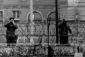 East German guards watching over the Berlin wall during Queen Elizabeth and Prince Philip's visit on May 29, 1965.