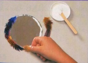 Glue the feathers to the mirror.