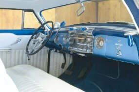 The white rolled-and-pleated upholstery accented the unique interiors of the custom Blue Danube perfectly.