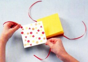 Stack the colored pages together and glue a stamped mat boards to each side.