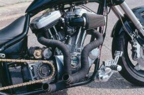 "Short, ""open"" exhaust pipes delete the Buell Street Fighter's muffler, cutting weight and back-pressure."