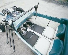 The interior of the Burk roadster was outfitted with a pressboard door and dash panels covered with pleated vinyl.