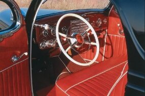 The interior of the Calori Coupe was impeccably finished with roll-and-pleat upholstery and contrasting white trim.