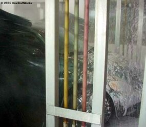The wax foam is applied to the car in a heavy coating.