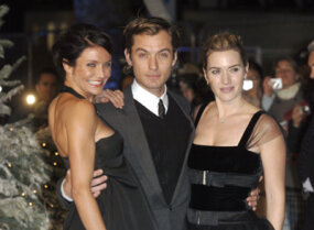 "Casting directors originally pictured Hugh Grant in the role that became Jude Law's in ""The Holiday."" Here Law, center, is pictured with co-stars Cameron Diaz, left, and Kate Winslet, right."