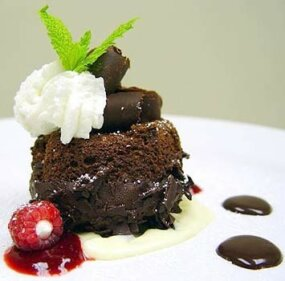 Today caterers want every aspect of an event to be just as perfect as the food. This chocolate souffle cake certainly looks perfect to us...