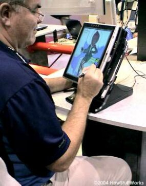 Caricature artist using Toshiba's tablet PC