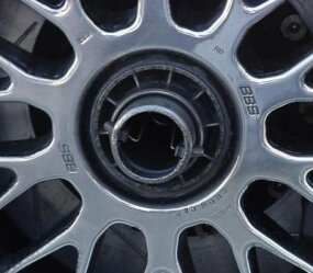 Tires are mounted on magnesium rims and attached to the car's hubs with a single locking bolt.