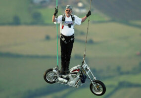 Stuntman Ian Ashpole gets ready to drop with his custom chopper ­from a hot air balloon at 3,000 feet.