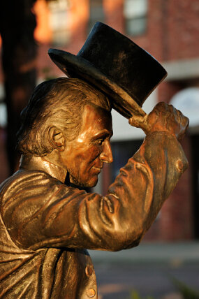 statue of james monroe lifting hat