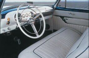 The interior was finished with pearl-white tuck-and-roll upholstery with blue piping.