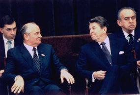 Soviet leader Mikhail Gorbachev (Left) and U.S. President Ronald Reagan exchange glances during a summit. ­