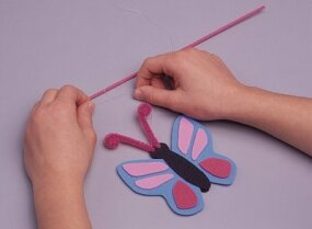 Attach the butterflies to the painted craft wands.