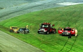 The aftermath of the crash that killed Dale Earnhardt, Sr. His car, the black #3, does not appear to be heavily damaged.