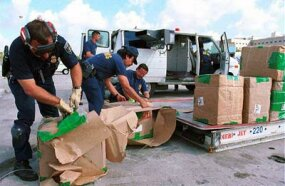 U.S. Customs inspectors check bulk shipments entering the United States.