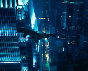 """Batman"" flies through the air in the fictional Gotham City."