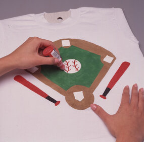 Draw stitching on pitcher's mound.