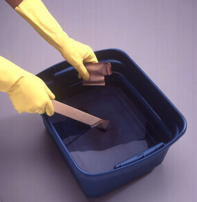 Prepare the dye bath in the bucket.