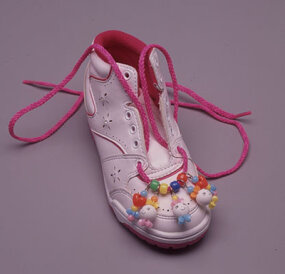 String beads onto shoelaces in the order shown.