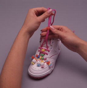 String heart-shaped beads onto both laces.