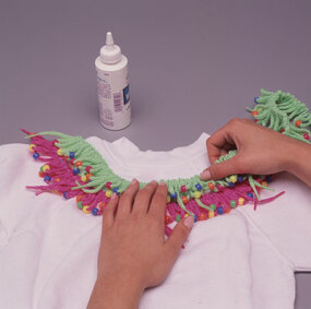Attach the pink and green laces with glue.