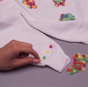 Glue beads along the cuffs.