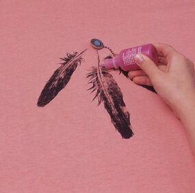 Sew on a silver button, and draw dots down the shaft of the feather using dimensional paint.
