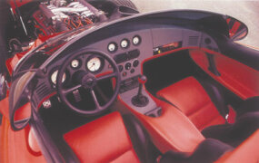 The show car's cockpit was all-business. Access to the pedals would be improved for production.
