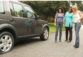 "Establishing shots, like this one of Hurricane Katrina survivors Leigh (Rochelle Aytes, L), Susan (Michael Hyatt, C) and Ivy (Taryn Manning, R) checking out their flat tire, give ""Drive"" a sense of realism."