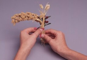 Bundle the wheat, millet spray, and flowers.