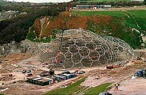 Workers assemble the steel framework of the greenhouses. The Eden Project crew broke the world record for largest free-standing scaffold.