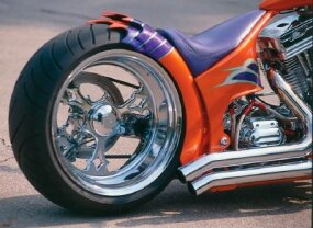 "Single-sided swingarm and combination brake disc/drive pulley allow the right side of the rear wheel to run ""naked."""